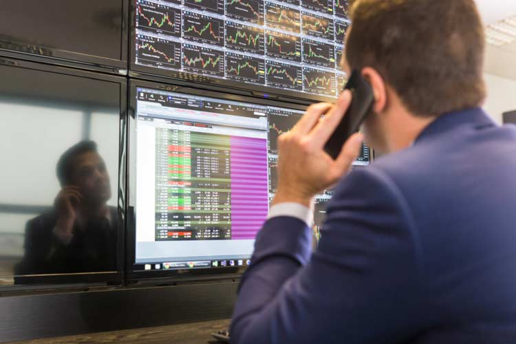 Stock-trader-on-phone
